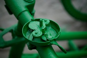 Green painted innards of a bicycle bell